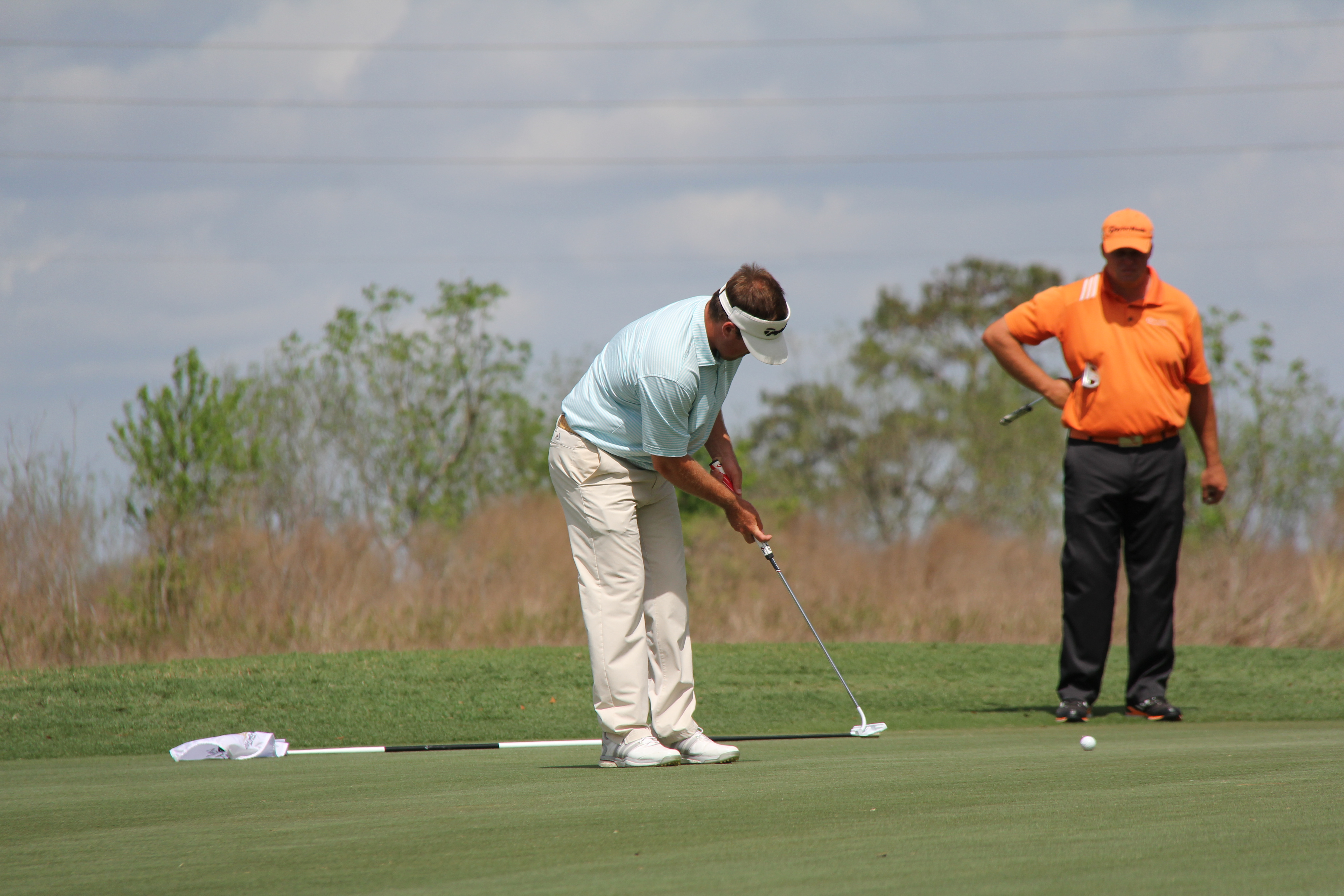 Putting during the Ocala Open